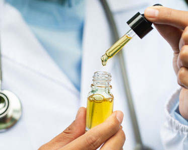 Doctor holding a bottle of hemp oil